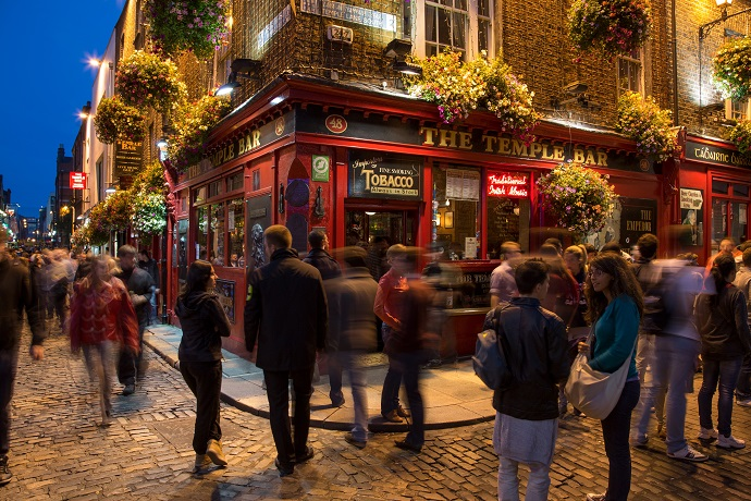 People outside The Temple Bar at night