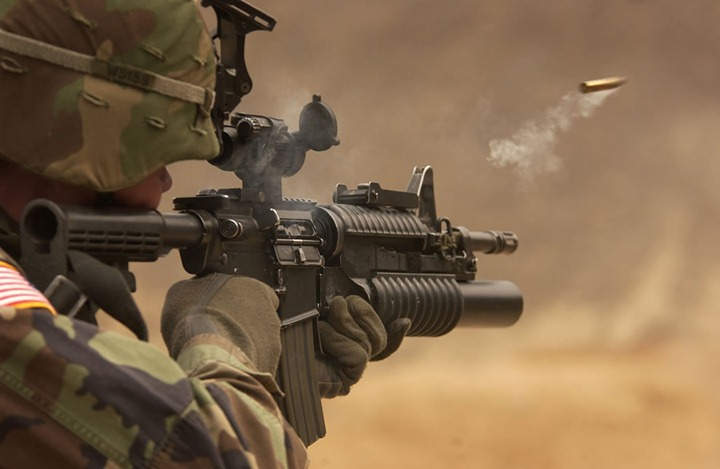 A-shell-casing-flies-out-with-a-trail-of-smoke-as-U.S.-Army-Pfc.-Michael-Freise-fires-an-M-4-rifle-during-a-reflex-firing-exercise-at-the-Rodriguez-Live-Fire-Complex-Republic-of-Korea