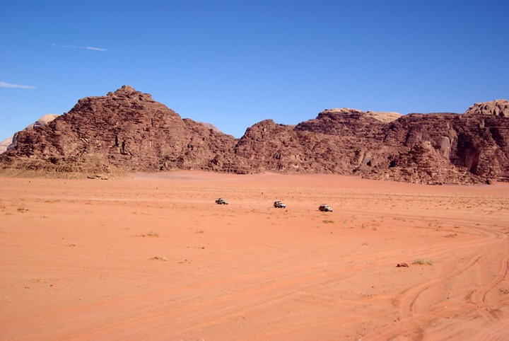 3-trucks-what-are-they-carrying-across-the-desert-of-wadi-rum