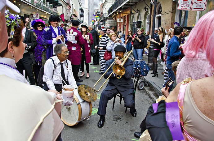 Crowds celebrating Mardi Gras on Bourbon Street