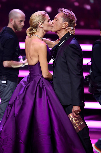 BERLIN, GERMANY - NOVEMBER 12: Heidi Klum and Wolfgang Joop kiss on stage during the Bambi Awards 2015 show at Stage Theater on November 12, 2015 in Berlin, Germany. (Photo by Andreas Rentz/Getty Images)