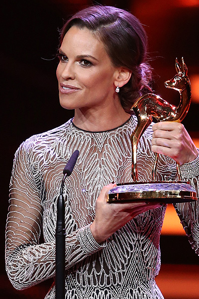 BERLIN, GERMANY - NOVEMBER 12: Hilary Swank is seen on stage with an award during the Bambi Awards 2015 show at Stage Theater on November 12, 2015 in Berlin, Germany. (Photo by Andreas Rentz/Getty Images)