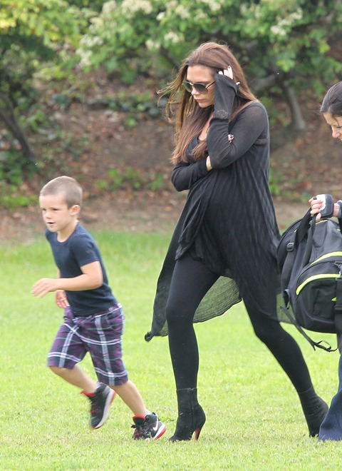 #7386453 EXCLUSIVE... It was head-to-toe slimming black for a pregnant and very showing Victoria Beckham as she attended her son Romeo's soccer session in Los Angeles, CA on May 28th, 2011. Between blowing hair and a blowing outfit it was a bit of work for the lovely mom to stay stylish.   Fame Pictures, Inc - Santa Monica, CA, USA - +1 (310) 395-0500