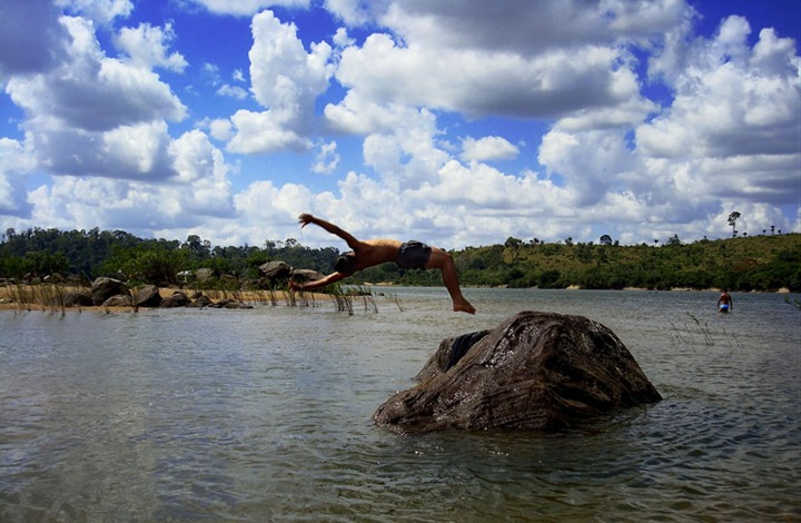 Rock-jumping-on-a-hot-day-as-the-rivers-of-Amazon-suffer-flooding-for-4-or-5-months-of-the-year