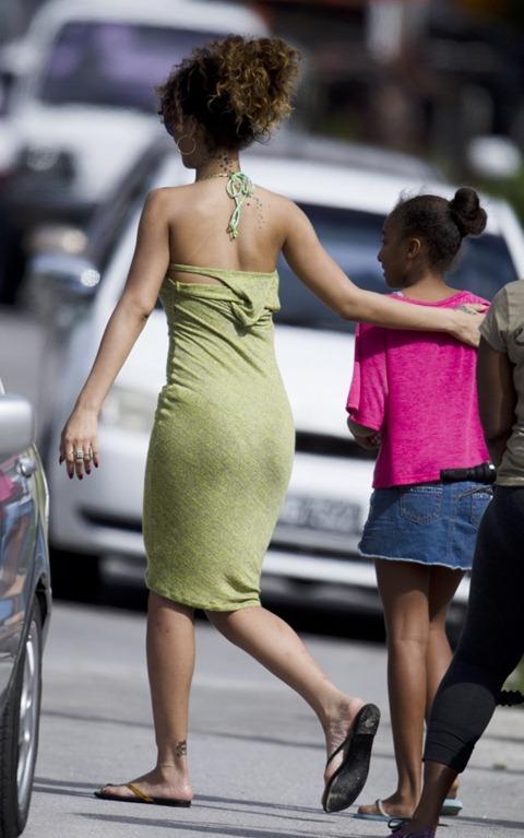 Rihanna - Leggy in Green Dress in Barbados-01-560x896